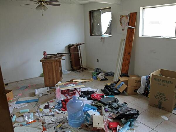 A picture containing indoor, wall, messy, cluttered